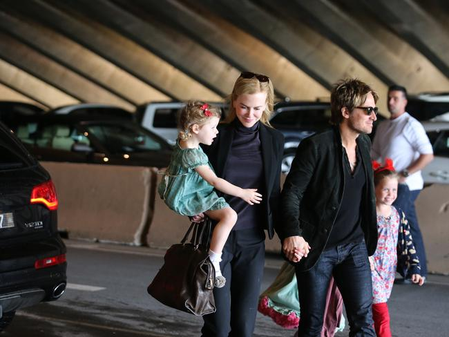 Happy family ... Nicole Kidman, Keith Urban their daughters arriving for a performance at the Sydney Opera House.