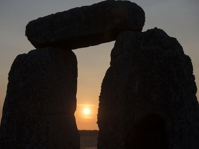 Singing stones ... the sun rises at the ancient stone circle Stonehenge, near Salisbury, on the Summer Solstice — the longest day of the year — on June 21, 2014.