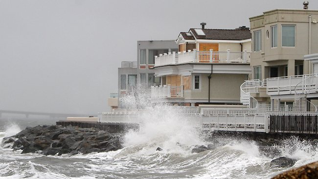 Waves crash onto the sea wall protecting homes in Longport, New Jersey. Picture: AP