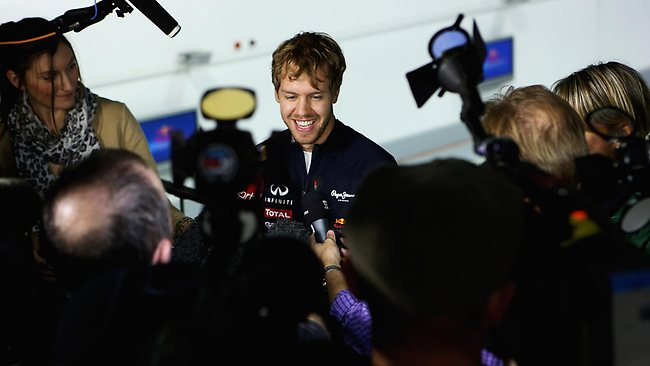 MILTON KEYNES, ENGLAND - NOVEMBER 27: Sebastien Vettel, F1 World Champion in 2010, 2011 and 2012 speaks to the media at the Red Bull Racing Press Conference at the Red Bull Racing Factory on November 27, 2012 in Milton Keynes, England. (Photo by Matthew Lewis/Getty Images)