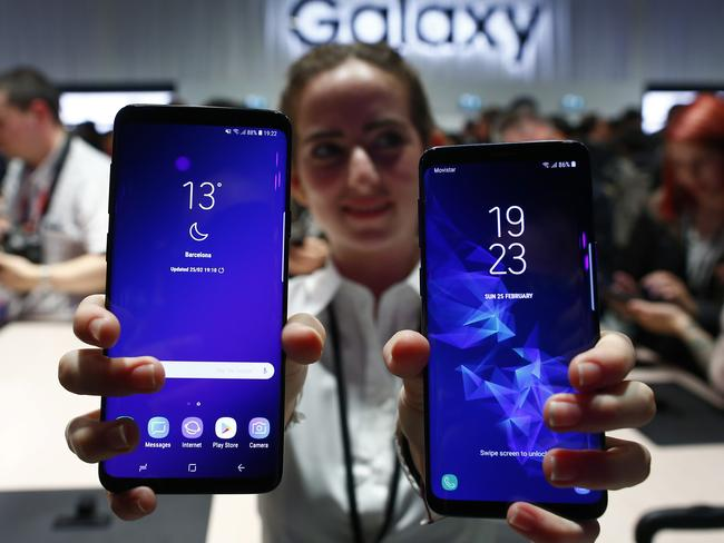 A woman holds the new Galaxy S9 and S9+ during the Samsung Galaxy Unpacked 2018 event on the eve of the Mobile World Congress. Picture: Manu Fernandez