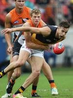 Out of reach ... Will Hoskin-Elliott tackles Brett Deledio. Picture: Phil Hillyard
