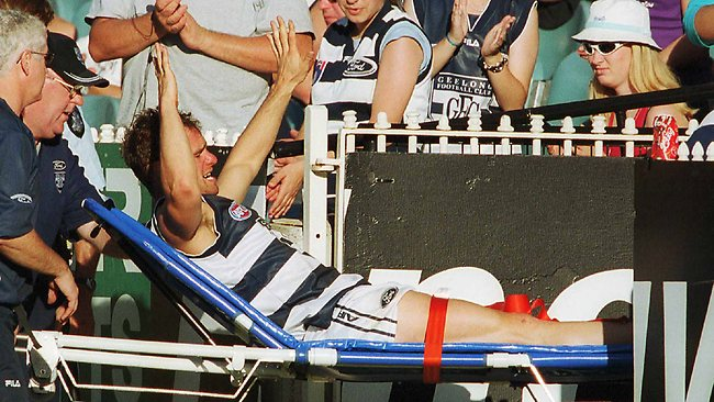 Geelong's Jason Snell leaves the field after injuring his ankle at the MCG in 2001. Picture: Craig Borrow