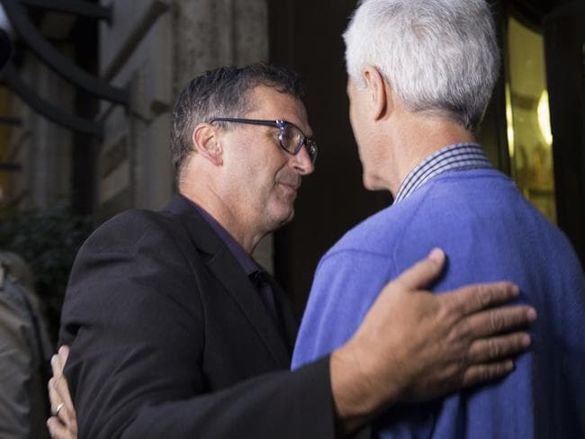 David Ridsdale, who was abused by a priest, comforts Anthony Foster, father of two girls who were abused by the clergy, after his meeting with Cardinal George Pell just minutes before. Picture: Ella Pellegrini