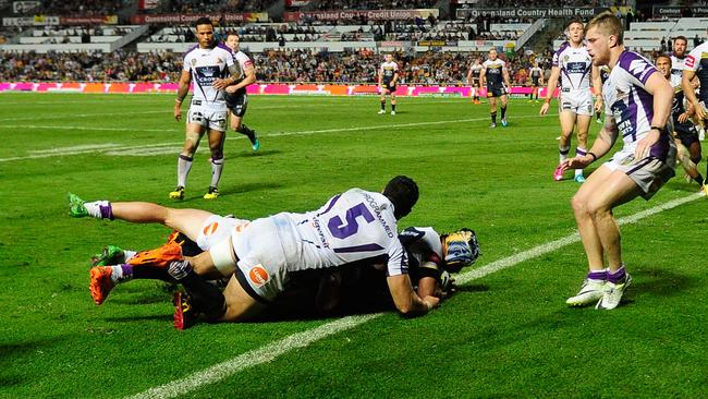 Johnathan Thurston of the Cowboys scores a try.
