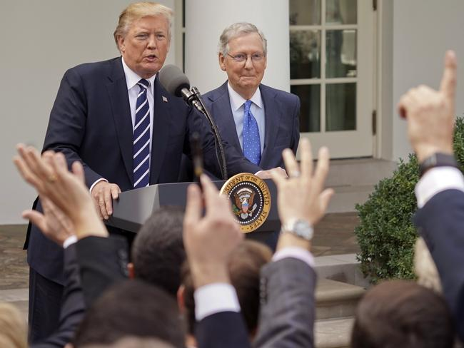 Donald Trump fields questions from reporters aside Senate majority leader Mitch McConnell on Monday afternoon. Picture: AP Photo/Pablo Martinez Monsivais