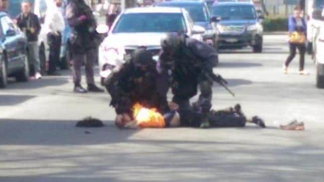 Twitter image posted by David Bartowski shows a police special response team taking down an unnamed man in Cabramatta. Picture: Twitter / David Bartowski