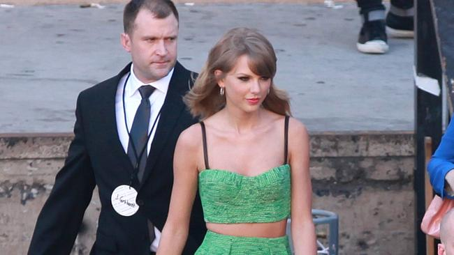 Taylor Swift's bodyguard looks pretty good in a suit.