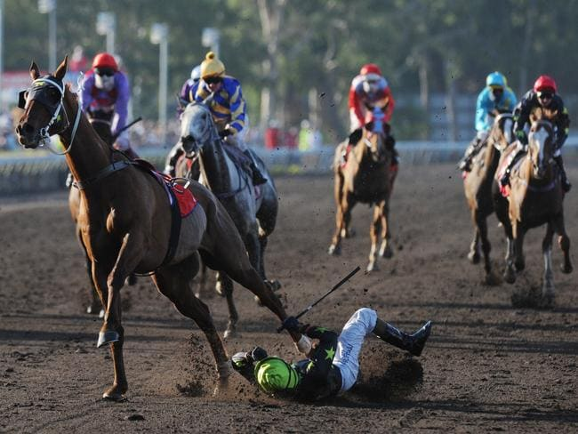Robbie Fradd crashes to the dirt moments after winning the Darwin Cup. Picture: Welsh Nicholas.