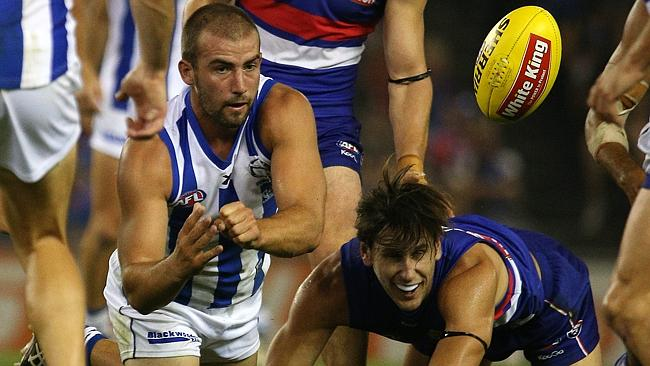 Cunnington flicks the ball out of congestion. Picture: George Salpigtidis