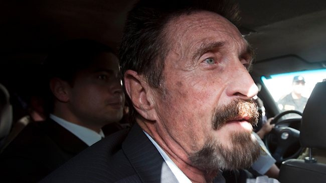 Software company founder John McAfee leaves an immigration detention centre for the La Aurora international airport in Guatemala City for being deported to Miami in the US. (AP Photo/Moises Castillo)