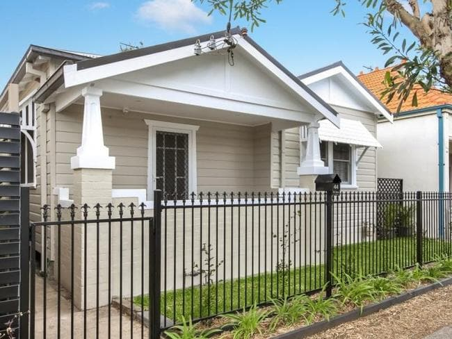 The house has now undergone a slick renovation including a neat paint job of the once peeling facade. Picture: Realestate.com.au