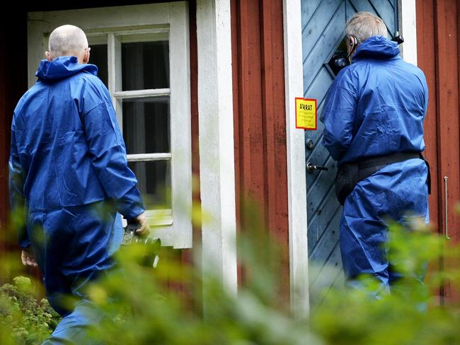 Police search Trenneborg's home. Picture: IBL/REX/Shutterstock