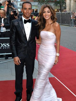 Lewis Hamilton and Nicole Scherzinger attend the GQ Men of the Year.