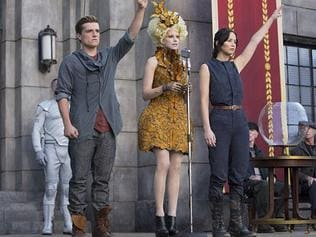 No tyranny ...  <i>The </i> <i>Hunger Games</i> heroes flash the salute at a rally.