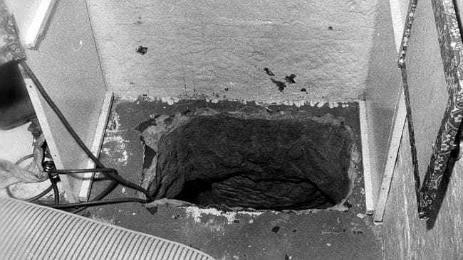 View of escape hole leading to a tunnel, cut through solid sandstone.