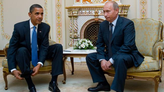 This awkward file photo taken on July 7, 2009 shows US President Barack Obama (L) and Russia's President Vladimir Putin meeting at the latter's country residence home in Novo Ogaryovo, near Moscow. Picture: AFP