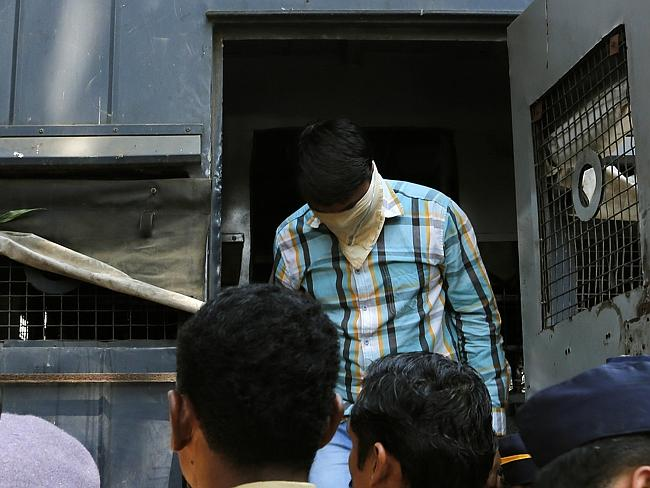 Hiding his face ... one of four men convicted of gang raping a photojournalist in India's financial capital.