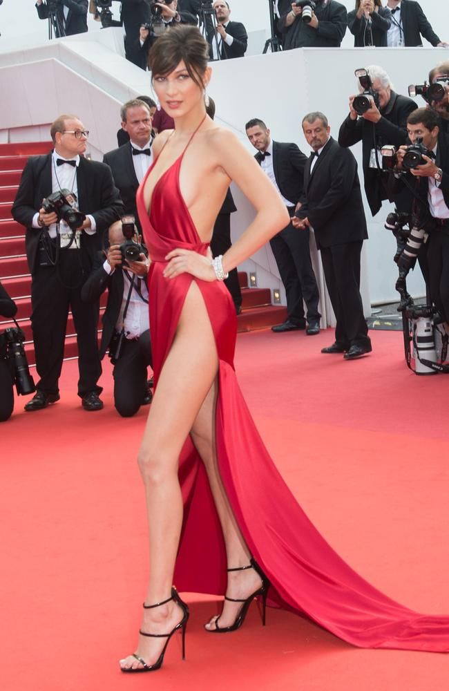Bella Hadid stunned in a barely-there gown in Cannes last year. Picture: Getty Images