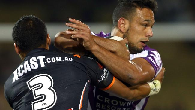 Tim Simona gets to grips with Will Chambers.