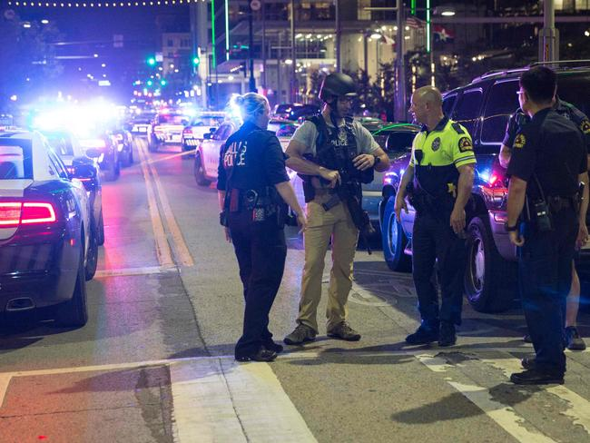 Police stand near a baracade following the sniper shooting in Dallas on July 7, 2016. Picture: AFP
