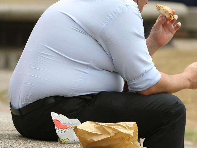 An overweight man eats fast food.. Picture date: Wednesday July 28, 2010. Photo credit should read: Dominic Lipinski/PA
