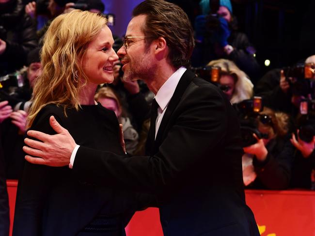 US actor Laura Linney (L) is greeted by Pearce upon arrival for the screening of the film Genius at the 66th Berlinale Film Festival in Berlin on February 16. Picture: AFP / John MacDougall