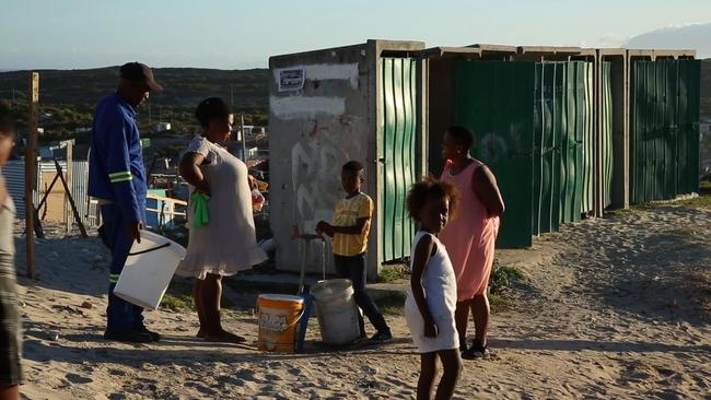 A boy in Khayelitsha fills up his bucket with precious water. Picture: SBS