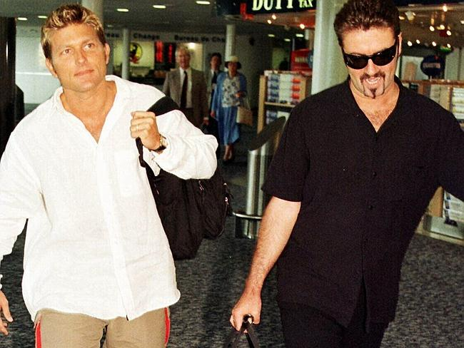 Singer George Michael (R) & Kenny Goss in 1998. Picture: AFP.