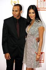 British Formula One world champion Lewis Hamilton and his partner, US singer Nicole Scherzinger pose before attending the 'Goldenes Lenkrad 2008' (Golden Wheel) awards in Berlin, 05/11/2008.