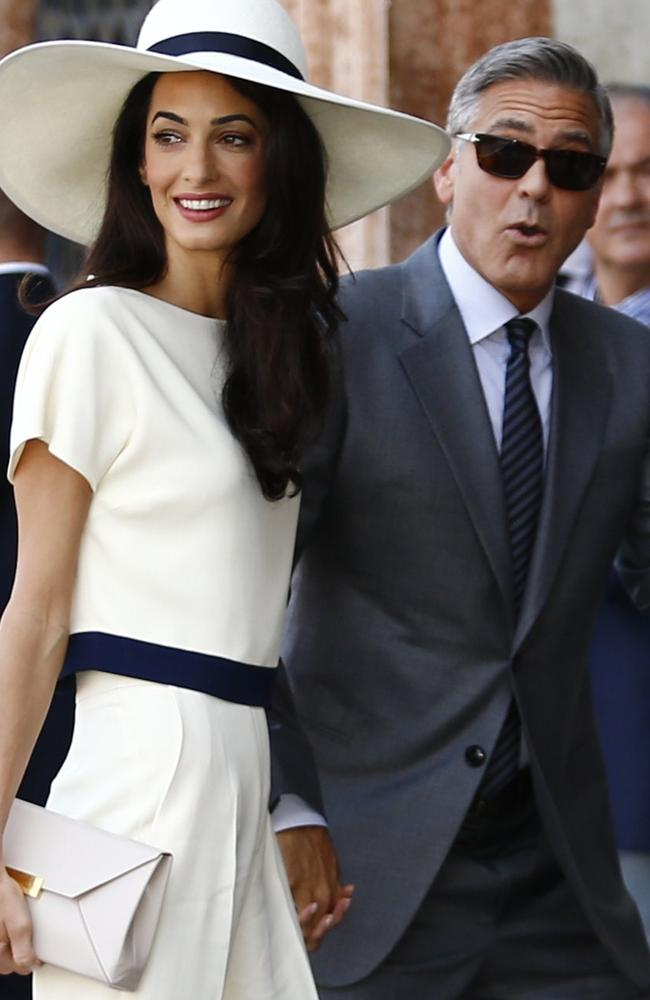 Newlyweds ... George Clooney and British lawyer Amal Alamuddin at the palazzo Ca Farsetti in Venice. Picture: AFP