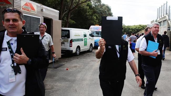 ASADA officials try to keep a low profile. Picture: Brett Costello