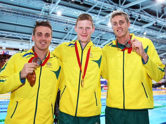 Gold medallist Rowan Crothers (C) poses with silver medallist Matthew Cowdrey (L) and bronze medallist Brenden Hall after the medal ceremony for the Men's 100m Freestyle S9 Final.