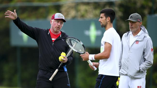 Novak Djokovic talks with his coach Boris Boris Becker and his fitness coach Gebhard Phil-Gritsch.