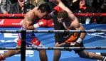 Australia's Jeff Horn (right) and Manny Pacquiao of the Philippines in action during their WBO World Welterweight title fight at Suncorp Stadium in Brisbane, Sunday, July 2, 2017. (AAP Image/Dan Peled) NO ARCHIVING, EDITORIAL USE ONLY