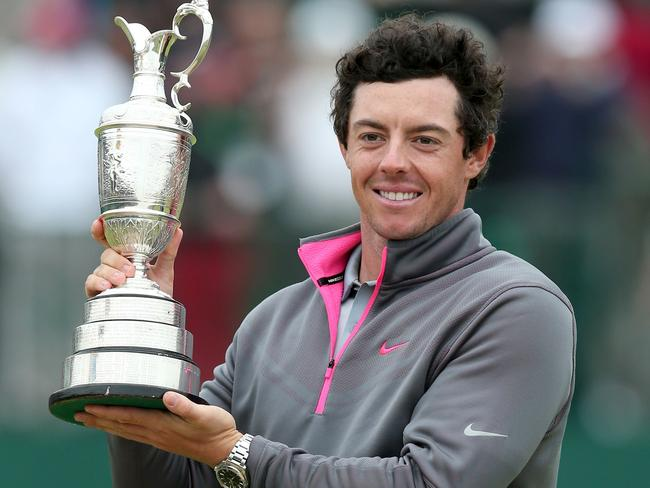 Rory McIlroy holds the Claret Jug after winning the 2014 British Open.