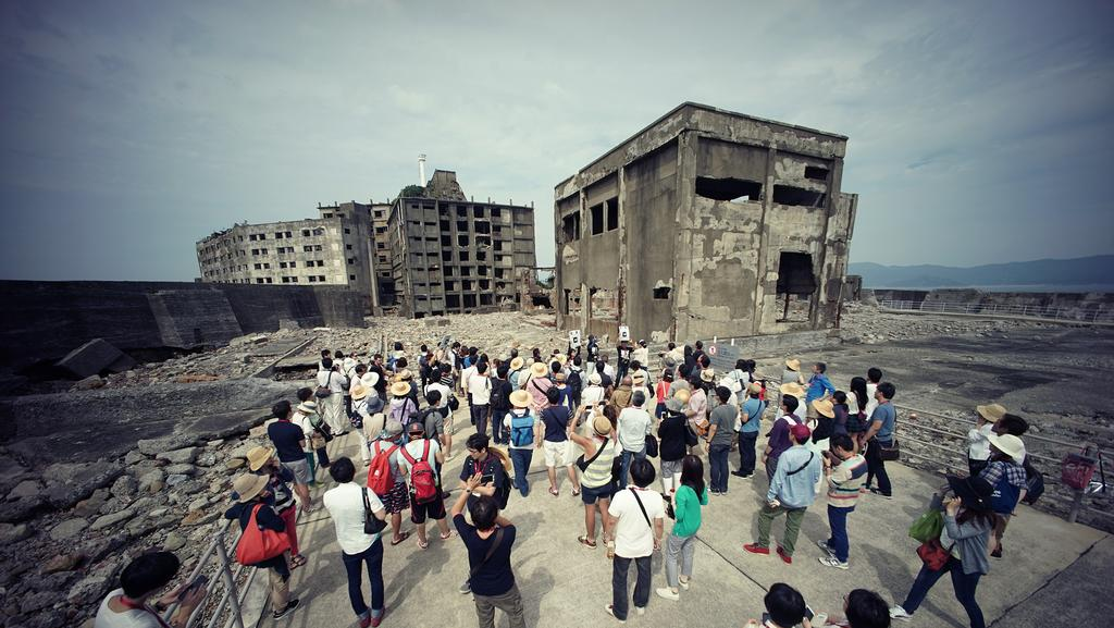 "Tourists visit ""Battleship Island,"" off Nagasaki."