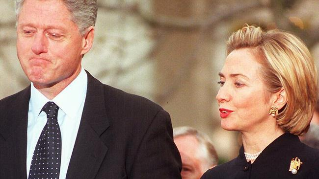 Bill and Hillary Clinton on the day the House of Representatives voted to impeach him.