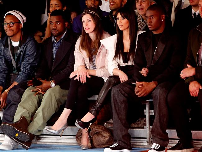 Awkward double date ... Kanye West, Milla Jovovich, Kim Kardashian and Reggie Bush attend New York Fashion Week in 2009.