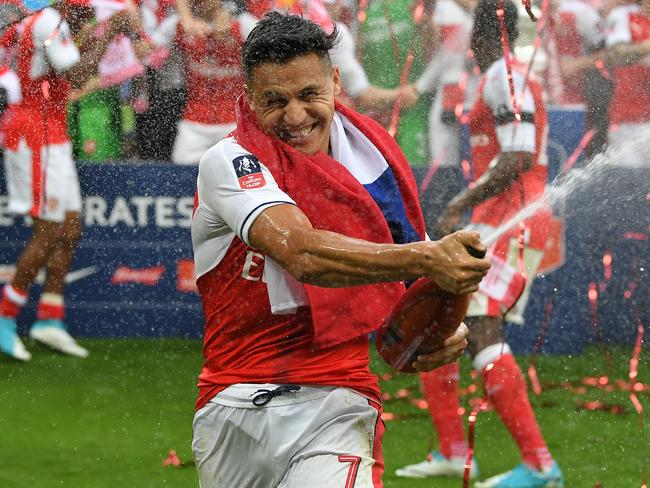 LONDON, ENGLAND — MAY 27: Alexis Sanchez of Arsenal celebrates victory after the Emirates FA Cup Final between Arsenal and Chelsea in May. Picture: Getty