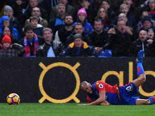Crystal Palace's English midfielder Andros Townsend reacts after being fouled by Middlesbrough's English midfielder Stewart Downing during the English Premier League football match between Crystal Palace and Middlesbrough at Selhurst Park in south London on February 25, 2017. / AFP PHOTO / Ben STANSALL / RESTRICTED TO EDITORIAL USE. No use with unauthorized audio, video, data, fixture lists, club/league logos or 'live' services. Online in-match use limited to 75 images, no video emulation. No use in betting, games or single club/league/player publications. /