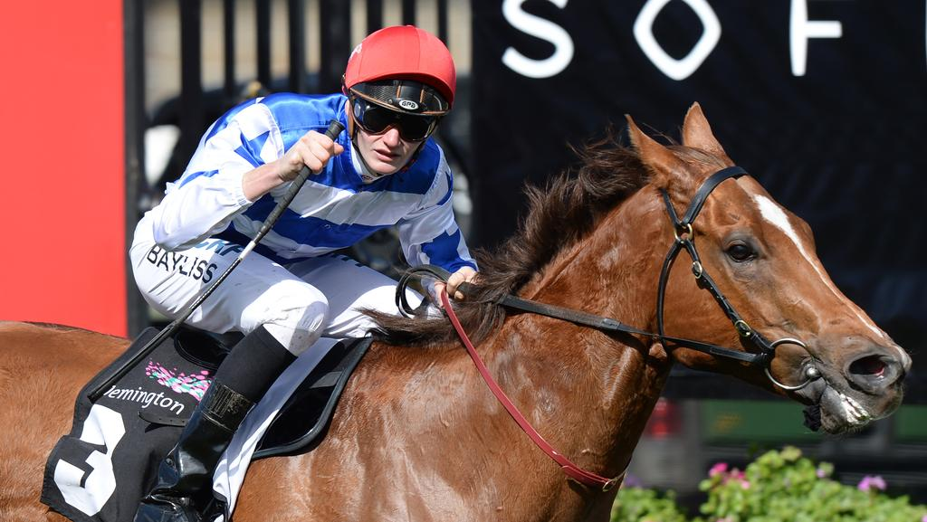 Jockey Regan Bayless on Redkirk Warrior on his way to winning race 4 the Bobbie Lewis Quality on Maybe Diva Stakes Day at Flemington Racecourse in Melbourne, Saturday, September 16, 2017. (AAP Image/Mal Fairclough) NO ARCHIVING, EDITORIAL USE ONLY