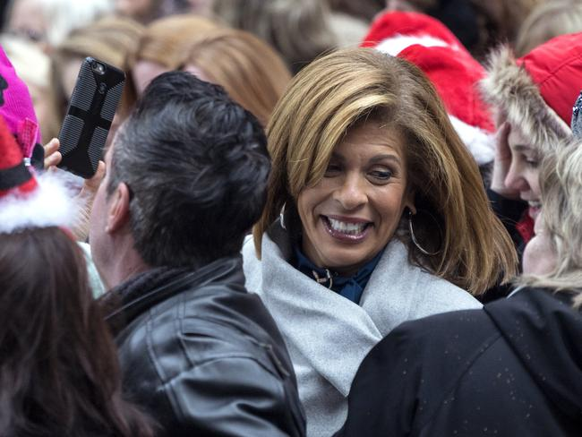 Anchor and co-host Hoda Kotb, centre, joins visitors during the broadcast outside the set of Today show in the wake of the firing Matt Lauer. Picture: