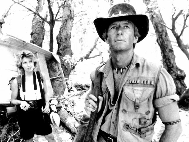 Scandal ... Hogan and Kozlowski in scene from hit mega hit 'Crocodile Dundee'. The pair famously caused a scandal after falling in love on set, with Hogan leaving his wife to be with his co-star.