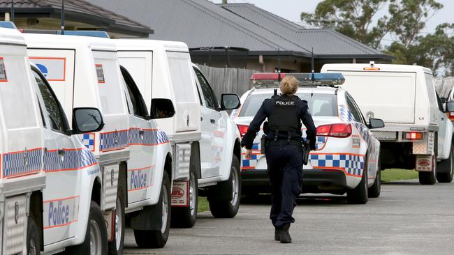 Police at a Loganlea home where a girl was taken from her bed. Picture: Steve Pohlner