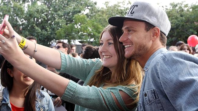 Kyal taking selfies with the fans.