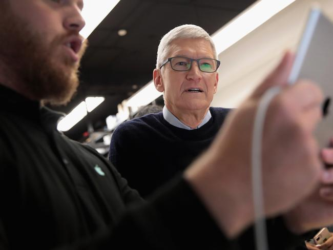 Apple CEO Tim Cook gets a demonstration of an app during an event held to introduce the new 9.7-inch Apple iPad at Lane Tech College Prep High School in Chicago. Picture: Scott Olson/Getty Images/AFP