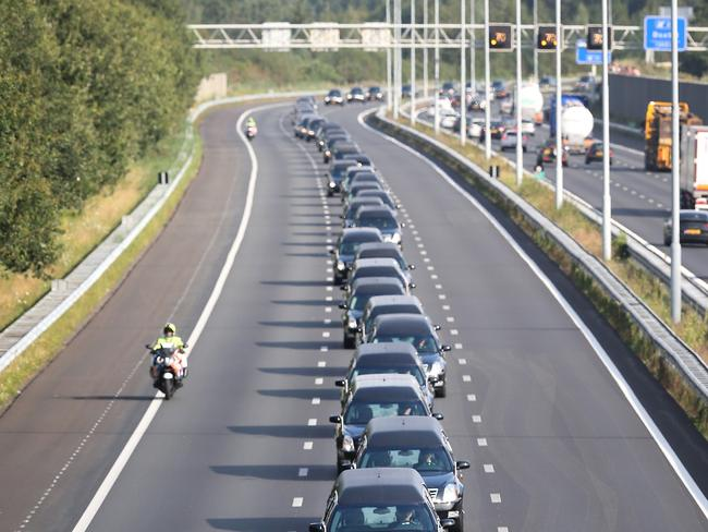 Sad procession ... A convoy of hearses carry bodies in Boxtel, Netherlands. Picture: Peter Macdiarmid