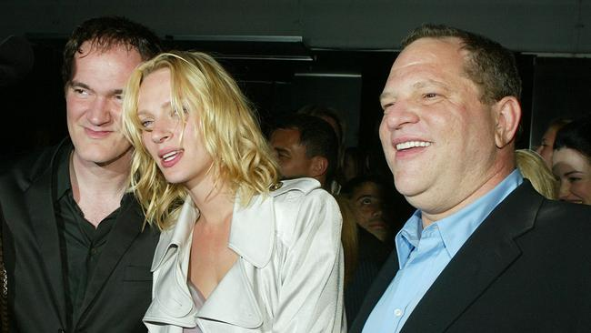Uma Thurman with Kill Bill 2 colleagues, director Quentin Tarantino (left) and executive producer Harvey Weinstein (right) in 2004. Picture: AFP