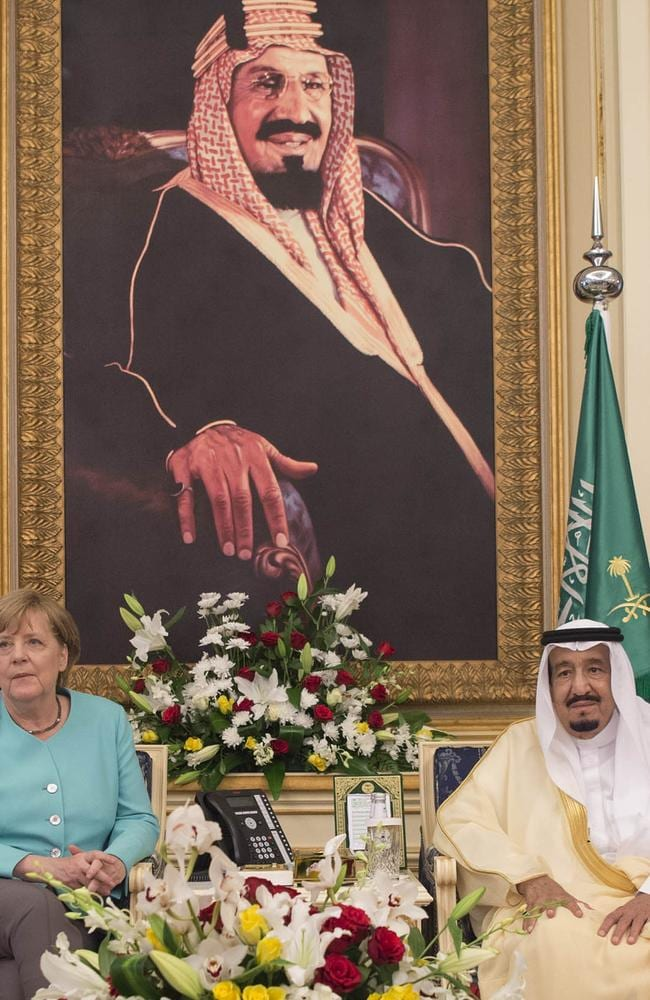 German Chancellor Angela Merkel with Saudi Arabia's King Salman bin Abdulaziz al-Saud in May before a giant portrait of the king's father, King Abdulaziz Ibn Saud.